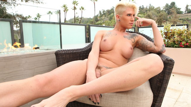 Danni Daniels shows off her feminine side in a sexy glamour shoot for shemalstrokers.com